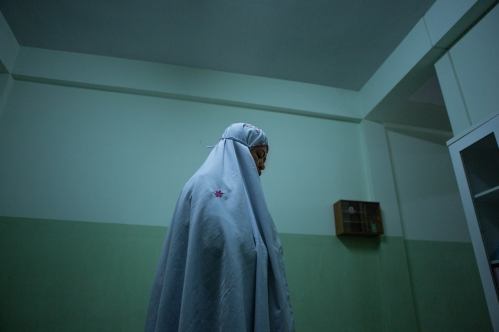 Dr. Nawal Laeni, 44, prays in the kitchen of a community NGO office in Pattani, Pattani province, Thailand on November 20, 2017. Working as an anesthesiologist at Pattani hospital for the past 7 years, Dr. Laeni has treated wounded Thai government forces, insurgents and innocent bystanders alike without discrimination.