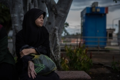 Lawiyah Doloh, 46, waits to see her detained son Mulid in the reception area of Ingkhayuth Borihan military camp in Pattani, Thailand on November 22, 2017. On November 8, 2017, Lawiyah's sons were arrested in their dorm and found in possession of a mobile phone that allegedly contained evidence of aiding nationalist insurgent groups. Though Anas was released after 7 days, Mulid has been charged with aiding terrorists and remains imprisoned.